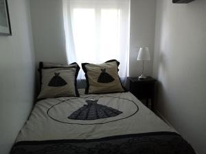 Un ou plusieurs lits dans un hébergement de l'établissement La Villa des Remparts