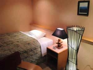 A bed or beds in a room at Hirosaki Toei Hotel