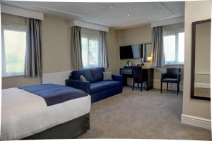 A television and/or entertainment center at Trafford Hall Hotel, BW Signature Collection by Best Western
