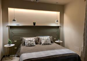 Letto o letti in una camera di B&B Villa del Sole Relais