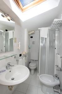 Salle de bains dans l'établissement Hotel Centrale