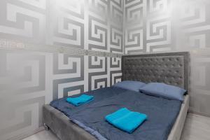 Postel nebo postele na pokoji v ubytování The H4 Executive Apartments