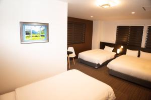 A bed or beds in a room at Hotel Kojan