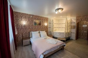 Кровать или кровати в номере Гостиница Глория