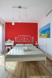 A bed or beds in a room at B&B Vivere il Mare