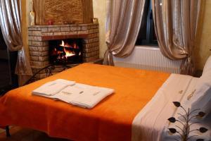Ein Bett oder Betten in einem Zimmer der Unterkunft Limnaio