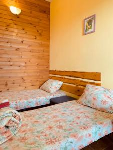 """A bed or beds in a room at Гостевой дом """"Дача Салтов"""""""