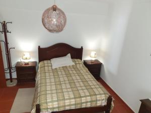 A bed or beds in a room at Casa em Palmela - Setúbal