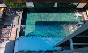 The swimming pool at or near BED Chiangmai Gate- Adults Only