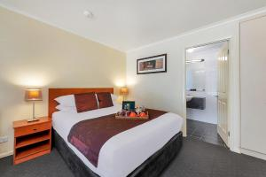 A bed or beds in a room at Beechworth Motor Inn