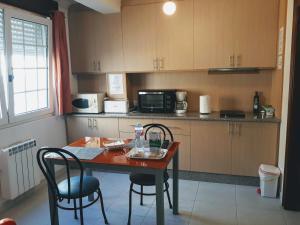 Una cocina o zona de cocina en Porta Nova Apartamentos