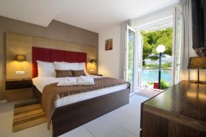 A bed or beds in a room at TUI Blue Kalamota Island