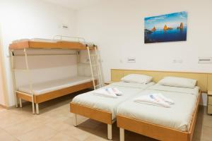 A bunk bed or bunk beds in a room at HI - Ein Gedi Hostel