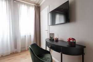 A television and/or entertainment center at Hotel Herion