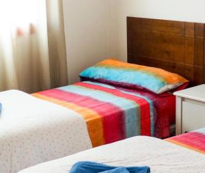 A bed or beds in a room at Buena Vida