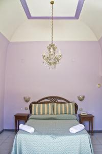 Letto o letti in una camera di Hotel Poseidon