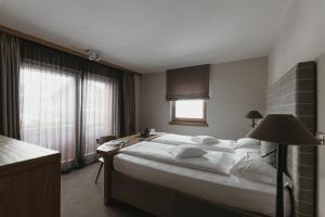Postel nebo postele na pokoji v ubytování Eco & Wellness Boutique Hotel Sonne
