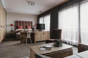 TV a/nebo společenská místnost v ubytování Eco & Wellness Boutique Hotel Sonne