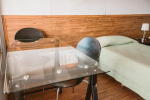 Cama o camas de una habitación en Hotel Nueva Palmira