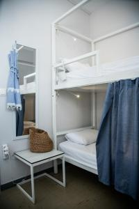 A bunk bed or bunk beds in a room at Thanasis Place