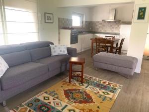 Area soggiorno di Cottage del fiume