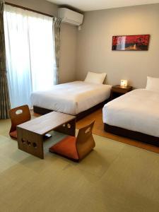 ゲストハウスゆかり京都にあるベッド