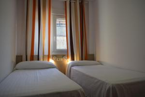 A bed or beds in a room at Apartamentos VIDA Finisterre