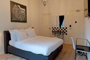 Un ou plusieurs lits dans un hébergement de l'établissement Bitterbal Amsterdam
