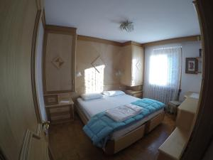 A bed or beds in a room at Majon Di Roces