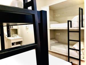 Litera o literas de una habitación en Hostel Quartier Leon Jabalquinto