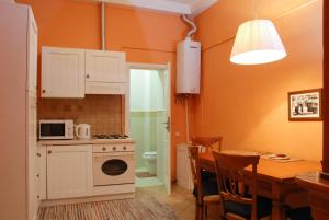 A kitchen or kitchenette at Central Apartments Lviv