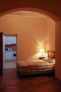 A bed or beds in a room at Central Apartments Lviv