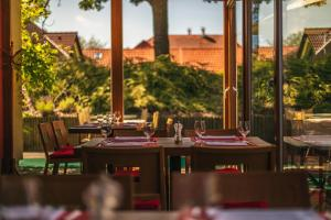 Een restaurant of ander eetgelegenheid bij Park Holiday Congress & Wellness Hotel