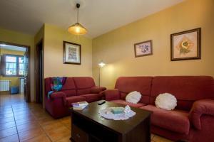 Zona de estar de Apartamentos Rurales Los Pontigos