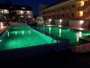 A piscina em ou perto de Lofts Complejo Playa Mar