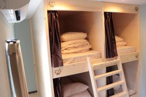 A bunk bed or bunk beds in a room at HOSTEL WONDER