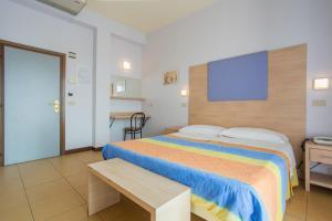 Letto o letti in una camera di Hotel City