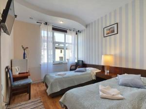 Łóżko lub łóżka w pokoju w obiekcie Pokoje Gościnne Wejherowo