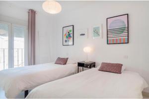 Säng eller sängar i ett rum på Apartments in Old Town