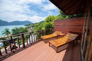 A balcony or terrace at Phi Phi The Beach Resort- SHA Certified