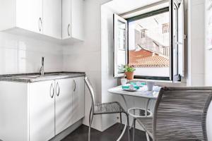 A kitchen or kitchenette at LoveLisbonApartments Alfama Best Balcony