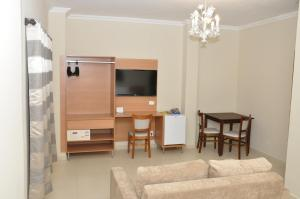 A television and/or entertainment center at Lotus Hotel