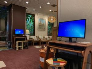 A television and/or entertainment center at Kyoto Garden Hotel