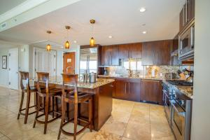 A kitchen or kitchenette at Honua Kai Resort and Spa