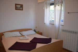 A bed or beds in a room at Apartments Leticia