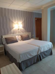 Cama o camas de una habitación en Sacromonte