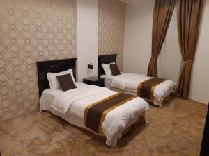 Cama ou camas em um quarto em دار البندقية للوحدات السكنية