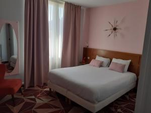 A bed or beds in a room at ibis Styles Le Havre Centre