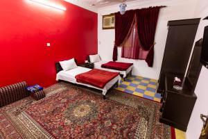 Cama ou camas em um quarto em Al Eairy Furnished Apartments - Al Bahah 3