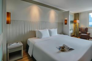 A bed or beds in a room at Windsor Plaza Hotel